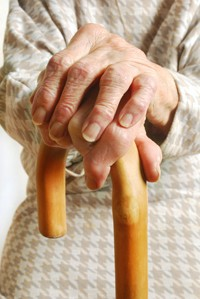 elderly woman's hands on walking stick